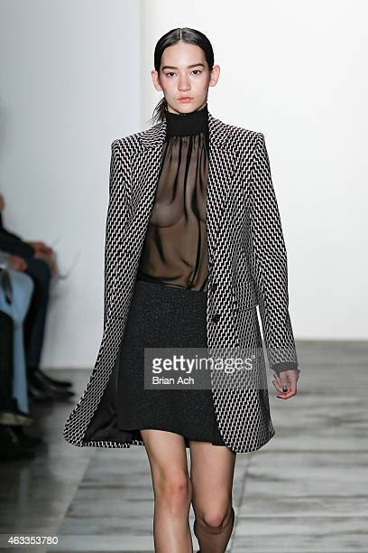 A model walks the runway during the Wes Gordon Runway MADE Fashion Week Fall 2015 at Milk Studios on February 13 2015 in New York City