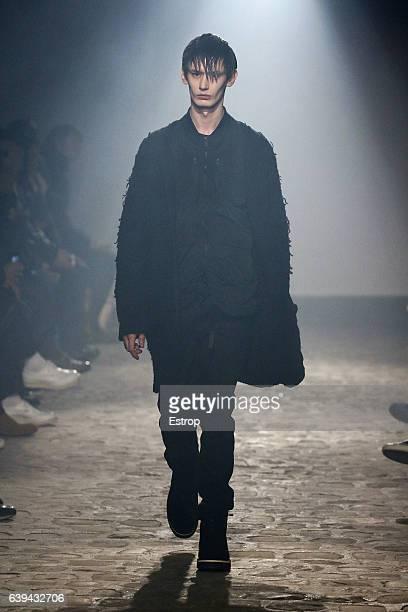 A model walks the runway during the White Mountaineering designed by Yosuke Aizawa Menswear Fall/Winter 20172018 show as part of Paris Fashion Week...