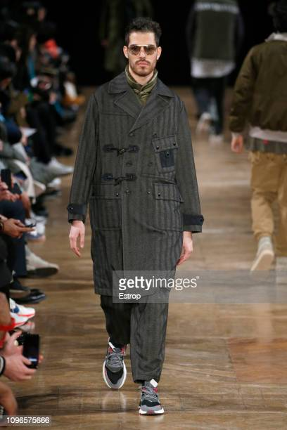 Model walks the runway during the White Mountaineering Menswear Fall/Winter 2019-2020 show as part of Paris Fashion Week on January 19, 2019 in...