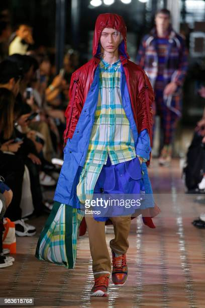 A model walks the runway during the White Moutaineering Menswear Spring/Summer 2019 show as part of Paris Fashion Week on June 23 2018 in Paris France