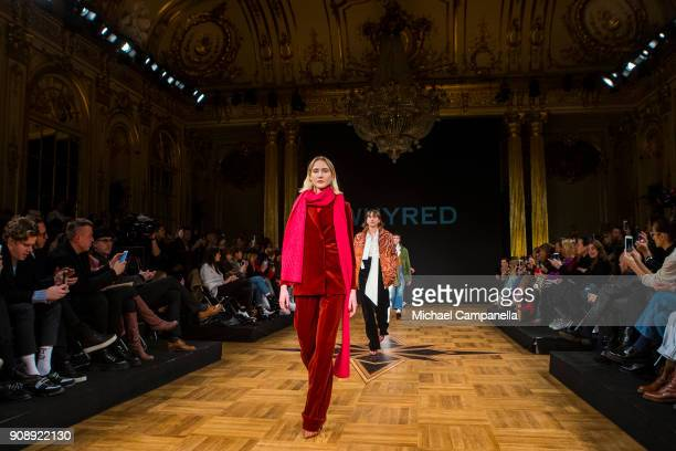 A model walks the runway during the Whyred show on the second day of Stockholm Fashion Week at the Grand Hotel on January 22 2018 in Stockholm Sweden
