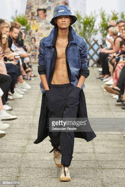 A model walks the runway during the William Fan defile during 'Der Berliner Mode Salon' Spring/Summer 2018 at Kronprinzenpalais on July 6 2017 in...