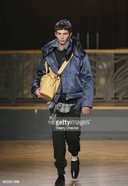 A model walks the runway during the Wooyoungmi Menswear Fall/Winter 20172018 show as part of Paris Fashion Week on January 21 2017 in Paris France