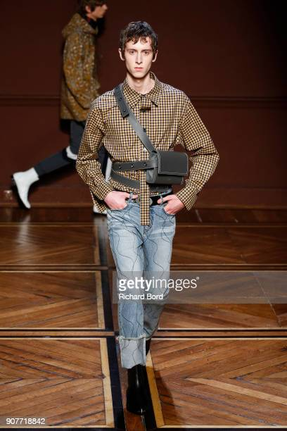 A model walks the runway during the Wooyoungmi Menswear Fall/Winter 20182019 show as part of Paris Fashion Week on January 20 2018 in Paris France