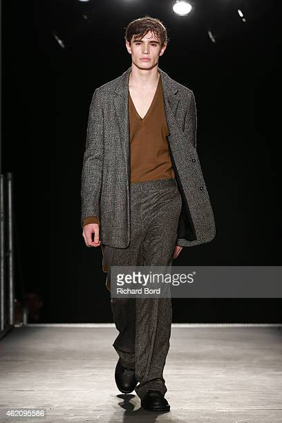 A model walks the runway during the Wooyoungmi Menswear Fall/Winter 20152016 show at Palais de Tokyo as part of the Paris Fashion Week on January 24...