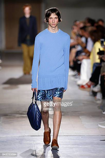 A model walks the runway during the Wooyoungmi Menswear Spring/Summer 2017 show as part of Paris Fashion Week on June 25 2016 in Paris France