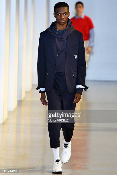A model walks the runway during the Wooyoungmi Menswear Spring/Summer 2018 show as part of Paris Fashion Week on June 24 2017 in Paris France