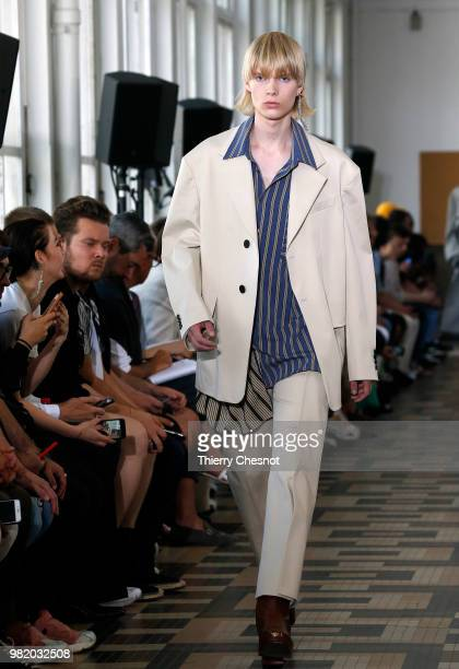 A model presents a creation by Wooyoungmi during the men's Spring/Summer 2019 collection fashion show on June 23 2018 in Paris