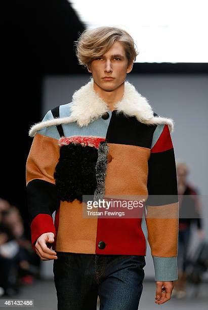 A model walks the runway during the Xander Zhou show at the London Collections Men AW15 at The Old Sorting Office on January 12 2015 in London England