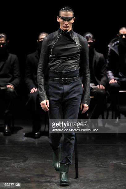 Model walks the runway during the Y. Project By Yohan Serfaty Men Autumn / Winter 2013 show as part of Paris Fashion Week on January 16, 2013 in...
