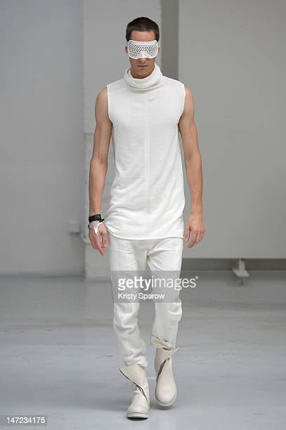 A model walks the runway during the Y Project By Yohan Serfaty Menswear Spring/Summer 2013 show as part of Paris Fashion Week on June 27 2012 in...