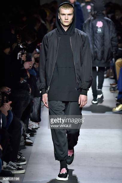 A model walks the runway during the Y3 Menswear Fall/Winter 20182019 show as part of Paris Fashion Week on January 21 2018 in Paris France