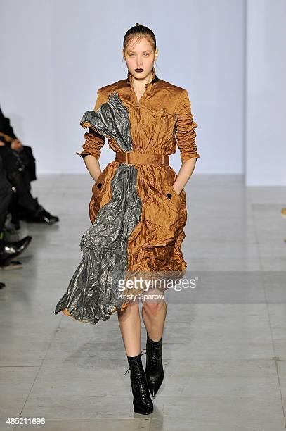 A model walks the runway during the Yang Li show as part of Paris Fashion Week Womenswear Fall/Winter 2015/2016 at Palais Des Beaux Arts on March 4...