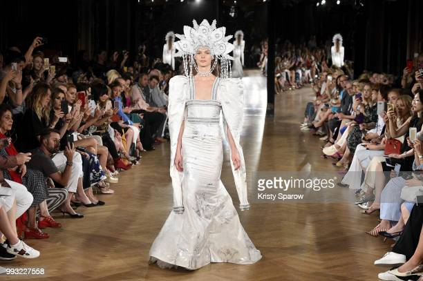 A model walks the runway during the Yanina Couture Haute Couture Fall Winter 2018/2019 show as part of Paris Fashion Week on July 3 2018 in Paris...