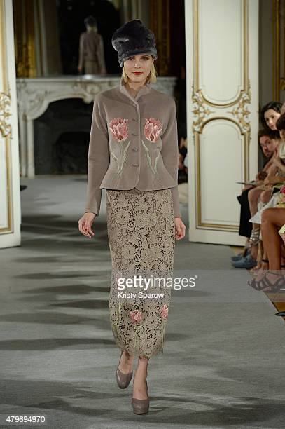 A model walks the runway during the Yanina Couture show as part of Paris Fashion Week Haute Couture Fall/Winter 2015/2016 on July 6 2015 in Paris...