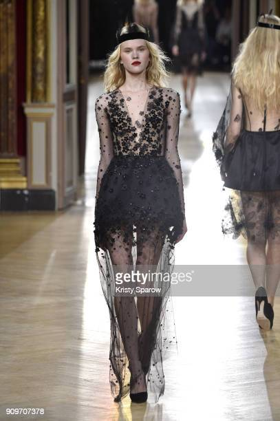 A model walks the runway during the Yanina Couture Spring Summer 2018 show as part of Paris Fashion Week on January 23 2018 in Paris France