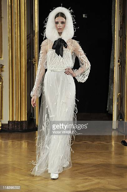 A model walks the runway during the Yanina Haute Couture Fall/Winter 201112 show as part of the Paris Haute Couture Fashion Week on July 05 2011 in...