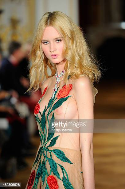 A model walks the runway during the Yanina show as part of Paris Fashion Week Haute Couture Spring/Summer 2015 on January 26 2015 in Paris France
