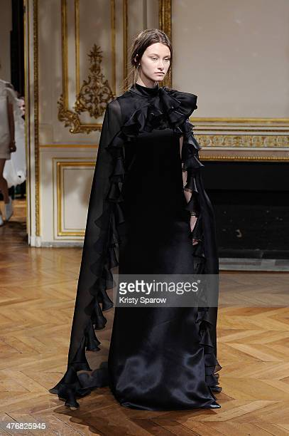 A model walks the runway during the YDE show as part of Paris Fashion Week Womenswear Fall/Winter 20142015 on March 5 2014 in Paris France