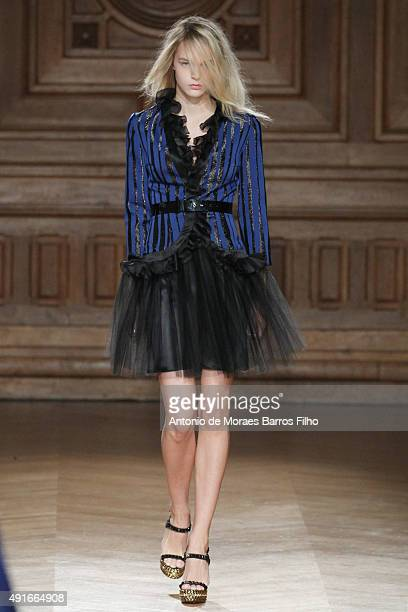 A model walks the runway during the YDE show as part of the Paris Fashion Week Womenswear Spring/Summer 2016 on October 7 2015 in Paris France