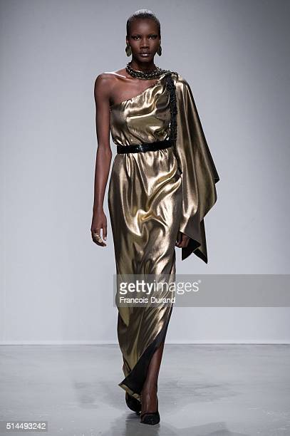 A model walks the runway during the YDE show as part of the Paris Fashion Week Womenswear Fall/Winter 2016/2017 on March 9 2016 in Paris France