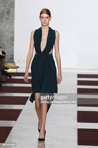 Model walks the runway during the Yiqin Ying show as part of Paris Fashion Week Haute Couture Spring/Summer 2015 on January 26, 2015 in Paris, France.