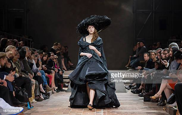 Model walks the runway during the Yohji Yamamoto fashion show 'Cutting Age' at St. Agnes Church on April 25, 2013 in Berlin, Germany.