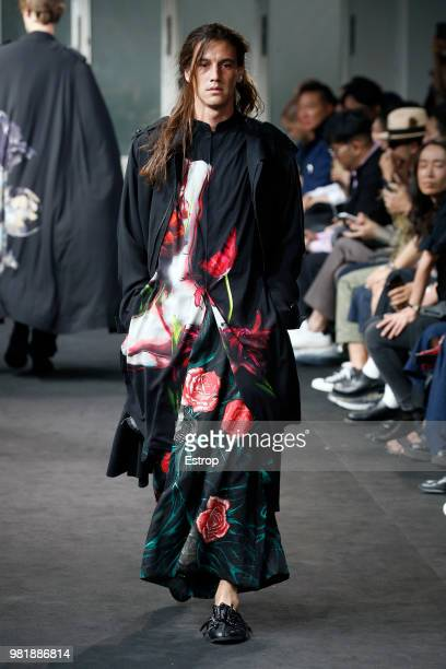 A model presents a creation by Yohji Yamamoto during the men's spring/summer 2019 collection fashion show on June 21 2018 in Paris