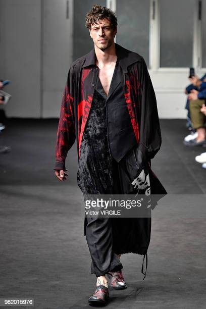 A model walks the runway during the Yohji Yamamoto Menswear Spring/Summer 2019 fashion show as part of Paris Fashion Week on June 21 2018 in Paris...