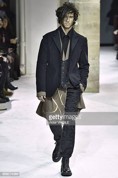 A model walks the runway during the Yohji Yamamoto Menswear Fall/Winter 20172018 show as part of Paris Fashion Week on January 19 2017 in Paris France