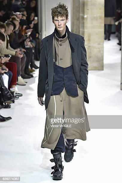 A model walks the runway during the Yohji Yamamoto Menswear Fall/Winter 20172018 show as part of Paris Fashion Week on January 19 2017 in Paris France