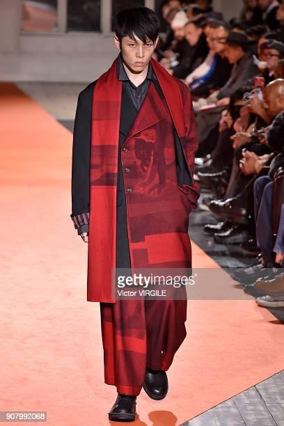 A model walks the runway during the Yohji Yamamoto Menswear Fall/Winter 20182019 show as part of Paris Fashion Week on January 18 2018 in Paris France