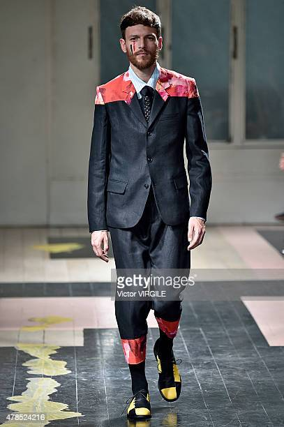 Model walks the runway during the Yohji Yamamoto Ready to Wear Menswear Spring/Summer 2016 show as part of Paris Fashion Week on June 25, 2015 in...