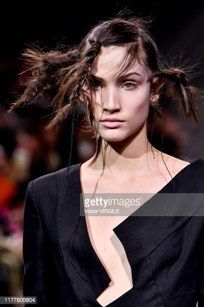 Model walks the runway during the Yohji Yamamoto Ready to Wear Spring/Summer 2020 fashion show as part of Paris Fashion Week on September 27, 2019 in...