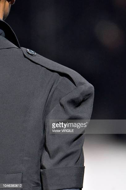 Model walks the runway during the Yohji Yamamoto Ready to Wear fashion show as part of the Paris Fashion Week Womenswear Spring/Summer 2019 on...