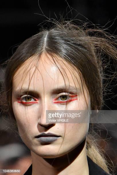 A model walks the runway during the Yohji Yamamoto Ready to Wear fashion show as part of the Paris Fashion Week Womenswear Spring/Summer 2019 on...
