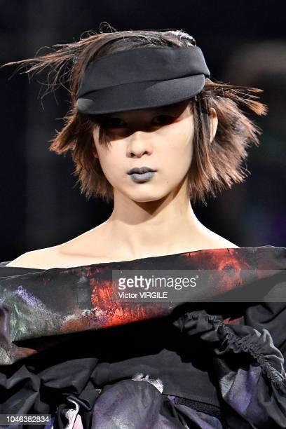 Model walks the runway during the Yohji Yamamoto Ready to Wear fashion show as part of the Paris Fashion Week Womenswear Spring/Summer 2019 on...