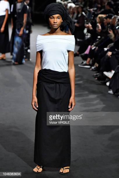 A model walks the runway during the Yohji Yamamoto Ready to Wear fashion show as part of the Paris Fashion Week Womenswear Spring/Summer 2019 on...