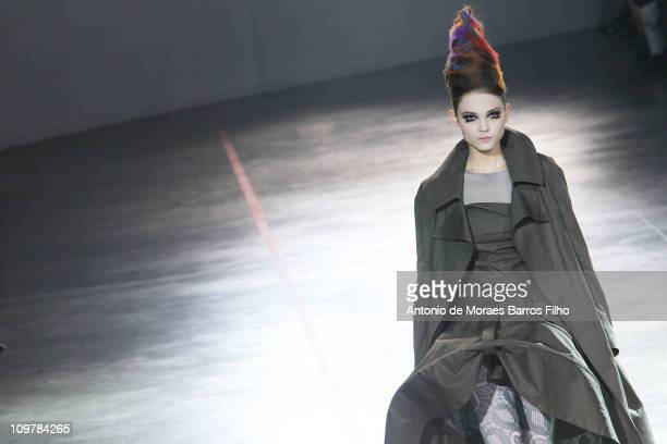 A model walks the runway during the Yohji Yamamoto Ready to Wear Autumn/Winter 2011/2012 show during Paris Fashion Week at Palais De Tokyo on March 4...