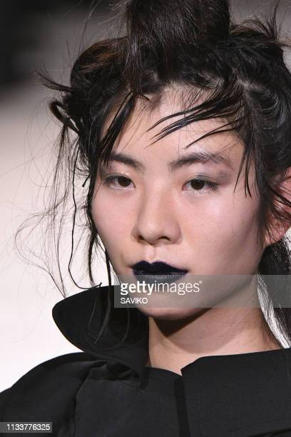 Model walks the runway during the Yohji Yamamoto Ready to Wear fashion show as part of the Paris Fashion Week Womenswear Fall/Winter 2019/2020 on...