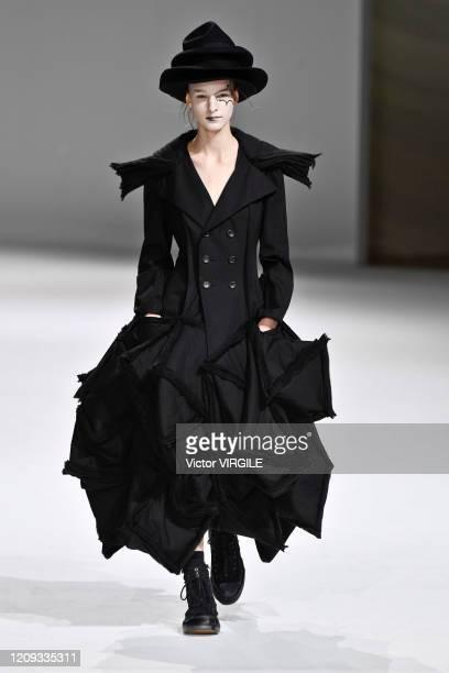 Model walks the runway during the Yohji Yamamoto Ready to Wear fashion show as part of the Paris Fashion Week Womenswear Fall/Winter 2020-2021 on...