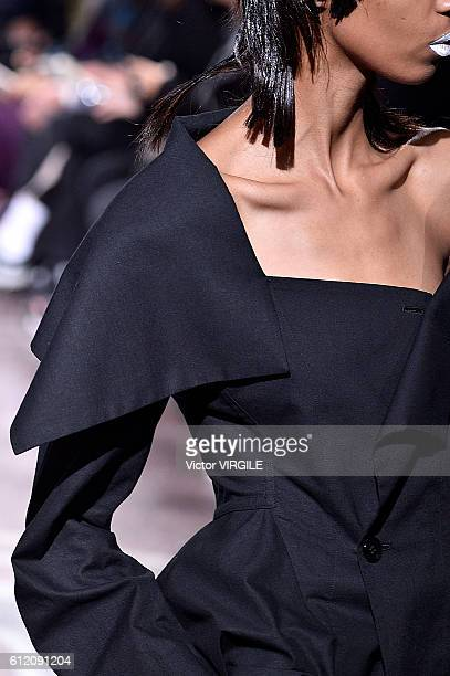 A model walks the runway during the Yohji Yamamoto Ready to Wera fashion show as part of the Paris Fashion Week Womenswear Spring/Summer 2017 on...
