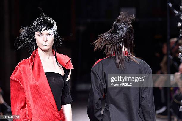 A model walks the runway during the Yohji Yamamoto Ready to Wera fashion show as part of the Paris Fashion Week Womenswear Spring/Summer 2017 on...