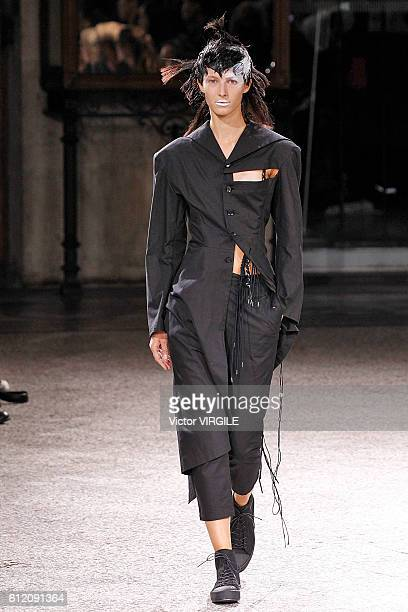 Model walks the runway during the Yohji Yamamoto Ready to Wera fashion show as part of the Paris Fashion Week Womenswear Spring/Summer 2017 on...