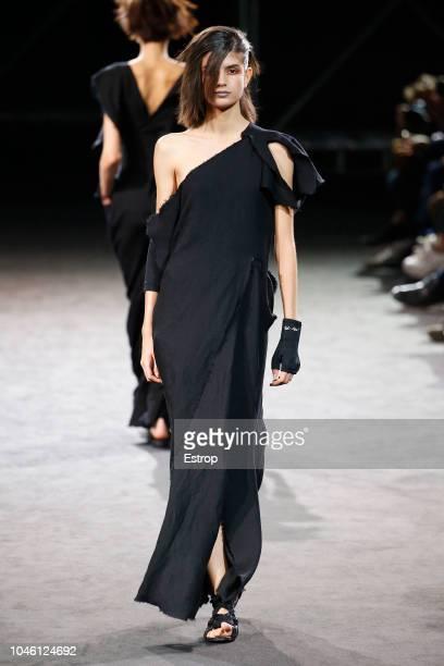 Model walks the runway during the Yohji Yamamoto show as part of the Paris Fashion Week Womenswear Spring/Summer 2019 on September 28, 2018 in Paris,...