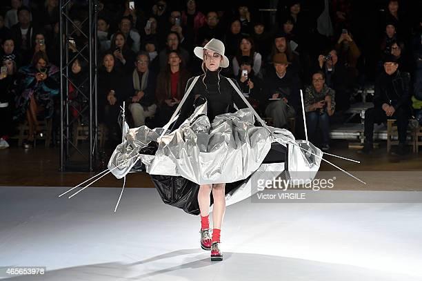 Model walks the runway during the Yohji Yamamoto show as part of the Paris Fashion Week Womenswear Fall/Winter 2015/2016 on March 6, 2015 in Paris,...