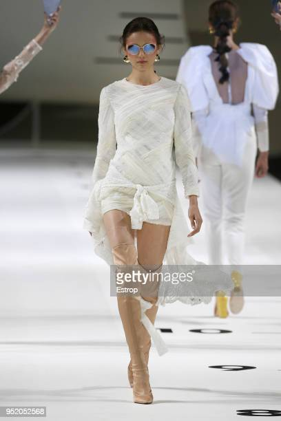 A model walks the runway during the Yolan Cris show as part of the Barcelona Bridal Week 2018 on April 26 2018 in Barcelona Spain