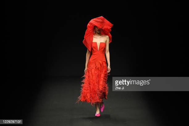 Model walks the runway during the YOUG X collection show by Chinese designer Xing Yong on day three of China Fashion Week at 751D.PARK on October 26,...