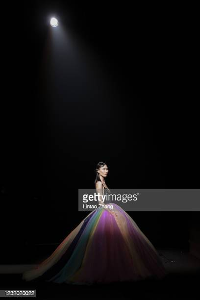 Model walks the runway during the YOUG X collection show by Chinese designer Xing Yong on day seven of China Fashion Week A/W 2021/2022 at 751D.PARK...