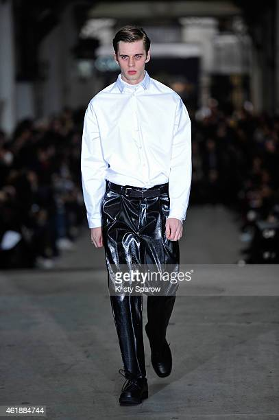 A model walks the runway during the Y/Project Menswear Fall/Winter 20152016 show as part of Paris Fashion Week on January 21 2015 in Paris France
